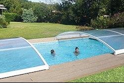 Abri piscine coulissant le plus modulaire for Piscine modulaire